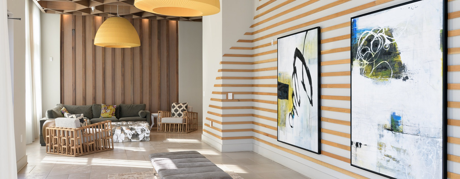 Lobby with couch and large hanging art